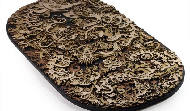 Laser cut wood illustrations by Martin Tomsky